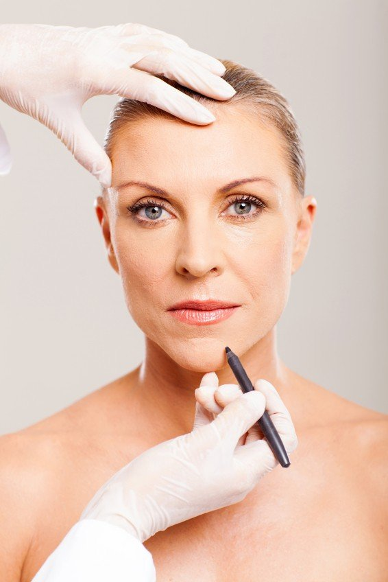 cosmetic surgeon marking mid age woman ANTI-AGEING TREATMENTS